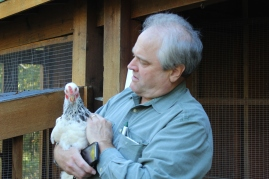 Bill Ruppert holding his chicken gal, Barbie. Photo by Holly Shanks.