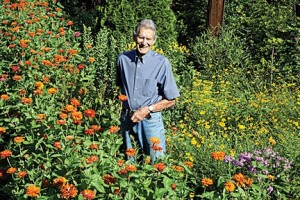 Weldon Cox stands in his pollinator garden. Photo by Diana Linsley.