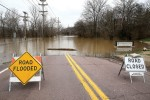 A completely submerged Marshall Road in front of Kirkwood Bluffs apartments in Kirkwood will only get worse as the Meramec River continues to rise. photo by Ursula Ruhl, South County Times.