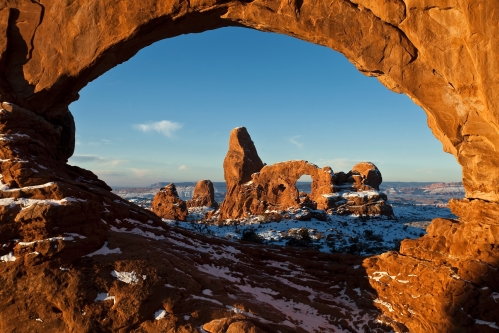 Turret Arch and North Window are two of the massive stone arches at the Windows Section in Arches National Park. Photo Credit: NPS/Jacob W. Frank.