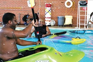 Learning the basics of kayaking in the medical center's swimming pool at Jefferson Barracks. Photo Credit: Ursula Ruhl, Webster-Kirkwood Times.