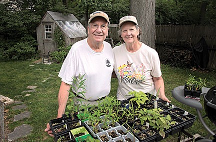 Fred and Susan Burk of Kirkwood with some of the native plants they plan to give visitors at the June 12 Sustainable Backyard Tour. photo by Diana Linsley, Webster-Kirkwood Times.